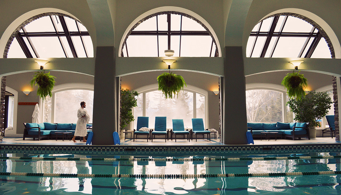 Indoor Pool with Mountain View | Fairmont Banff Springs Castle Hotel Gay-Friendly © CoupleofMen.com