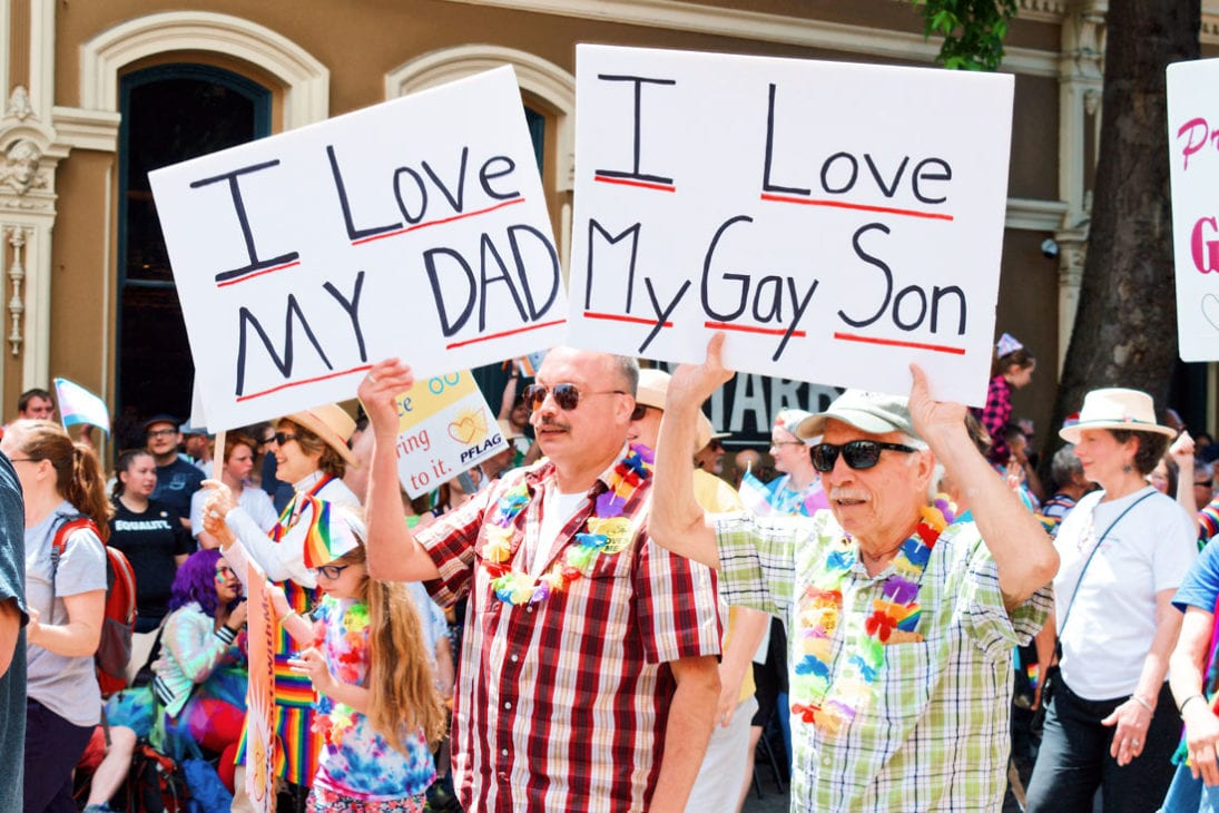 Pride LGBTQ+ rights Movement Proud son and a proud dad walking side by side © Coupleofmen.com